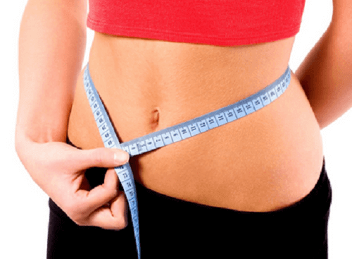 Vrouw met meetlint om de maag
