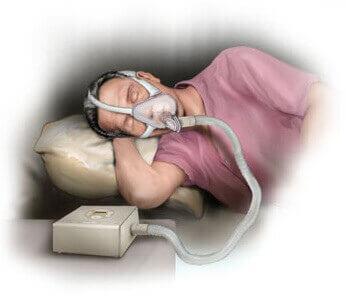 man slaapt met zuurstofmasker