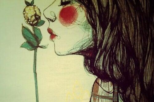 vrouw-ruikt-bloem