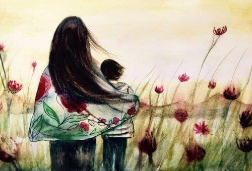Moeder en kind in bloemenveld