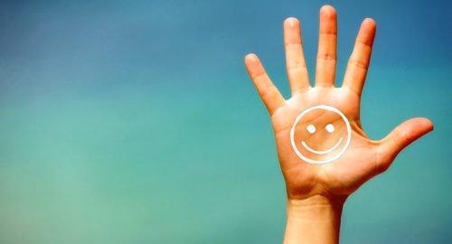 Hand met een smiley