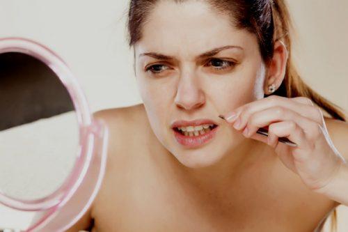 Overtollig gezichtshaar bij vrouwen verwijderen