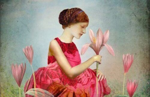 Meisje met een roze jurk en een roze lelie