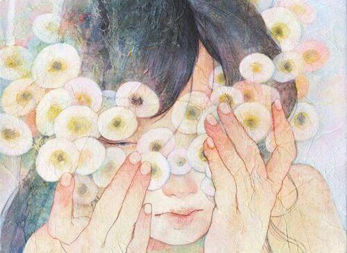 Meisje verstopt zich achter bloemen