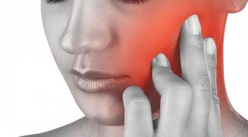 De oorzaken van kaakpijn