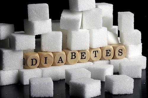 Suikerklontjes en letters die diabetes spellen