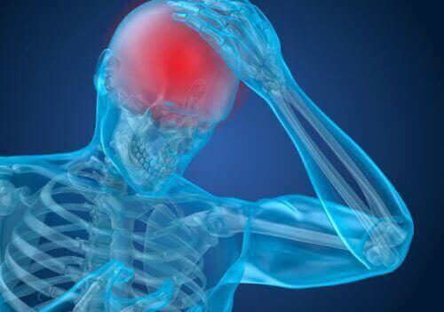 Een afbeelding van iemand met hoofdpijn waarbij de hersenen rood zijn gekleurd
