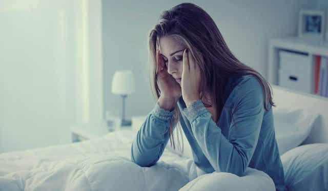 Vrouw kan niet slapen door de pijn